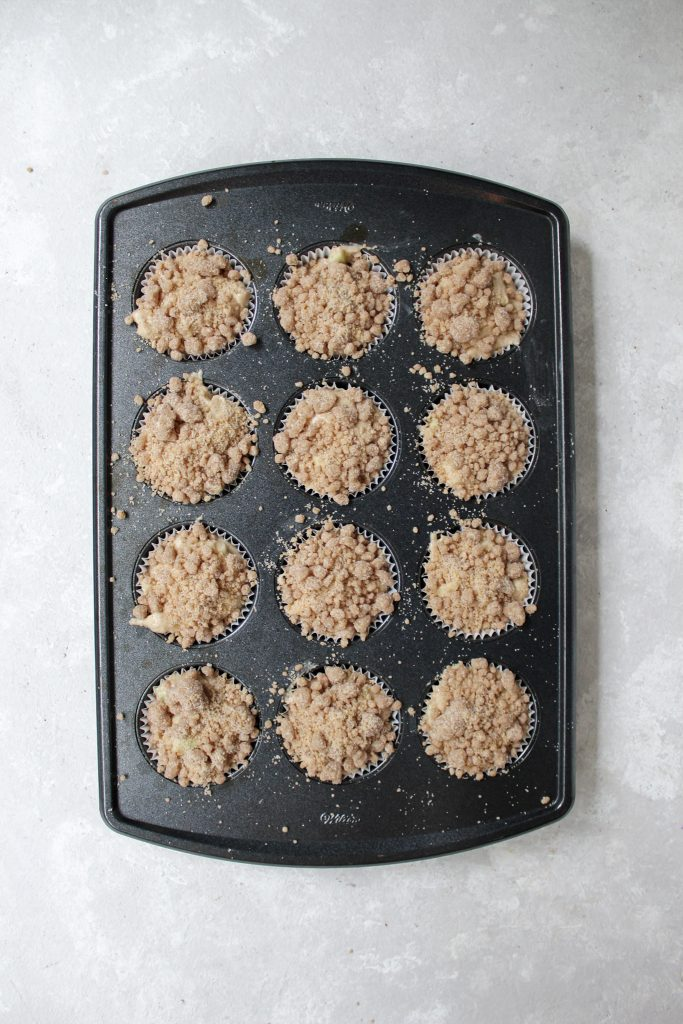 muffin batter with crumb topping in prepared tin pan