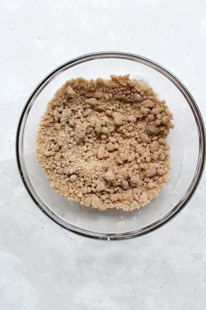 formed crumb topping in a glass bowl