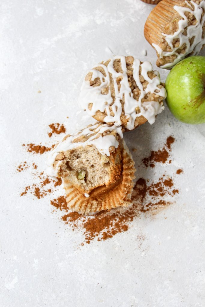 overhead shot of apple muffin with a bite taken out of it