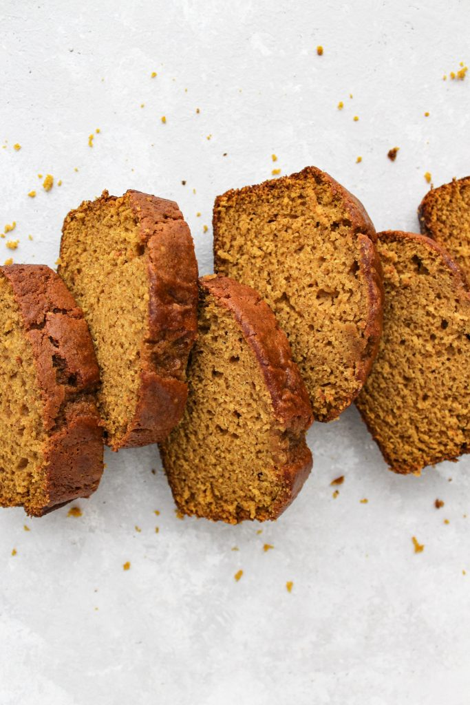 overhead shot of a horizontal line of pumpkin spice bread