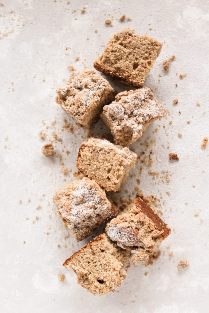 overhead shot of vertical line of apple cider cake pieces